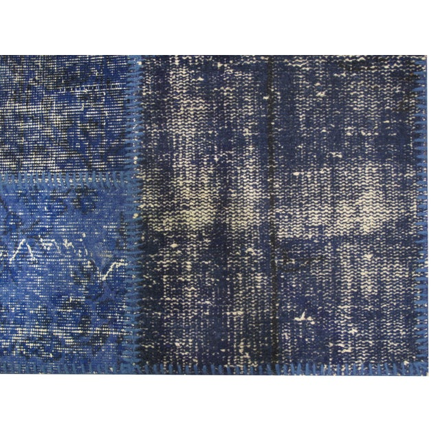 Perfect for the transitional interior, this vintage Turkish Patchwork Rug features a varying blue color scheme.