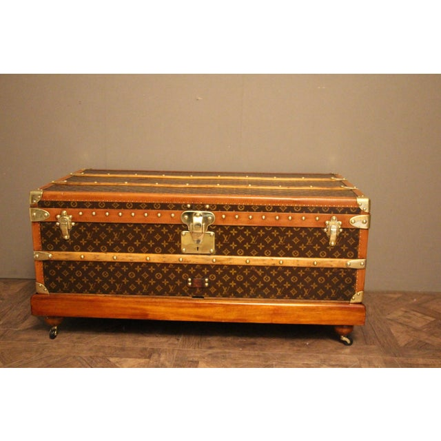 This beautiful Louis Vuitton trunk features stenciled hand painted monogram canvas and honey color lozine trim. All solid...
