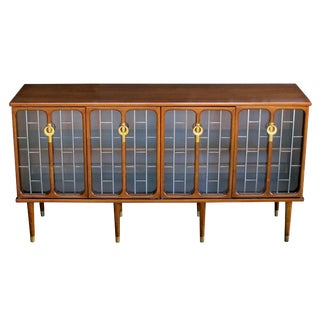 A Sophisticated American Mid-Century Modern Walnut 4-Door Credenza/Sideboard; Stamped 'White Furniture Company' For Sale