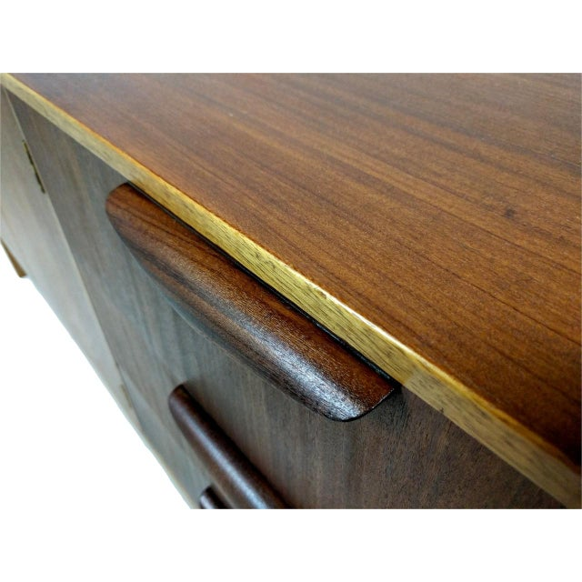 Mid-Century Modern wood credenza. Maker: Unknown European Designer: Unknown Origin: UK Circa: 1960/70S Width: 60 in....