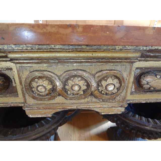 Outstanding Italian giltwood console table or center table with 1.5 inch thick marble top from the 17th century. Marble...