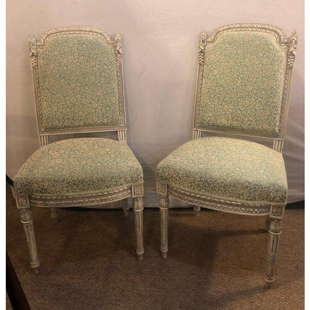 Pair of 19th-20th century paint decorated Louis XVI style Swedish side chairs. This fine pair of French Louis XVI style...