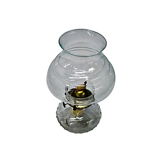 Vintage oil lamp in unused condition. Gorgeous scrollwork design clear glass hurricane and hobnail glass oil recipient.