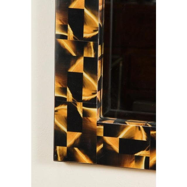 A R&Y Augousti horn inlay mirror.