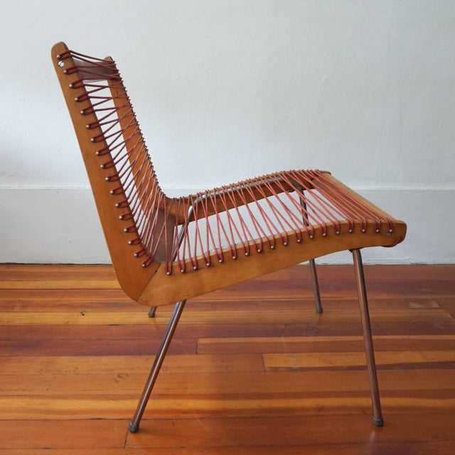 Wood and string chair by Robert J Ellenberger for Calfab Furniture Company, Los Angeles California. This design was...