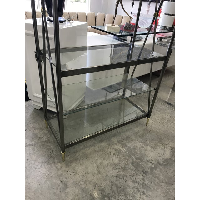This is a nice etagere by DIA in good fair condition, this etagere has a total of six glass shelves.