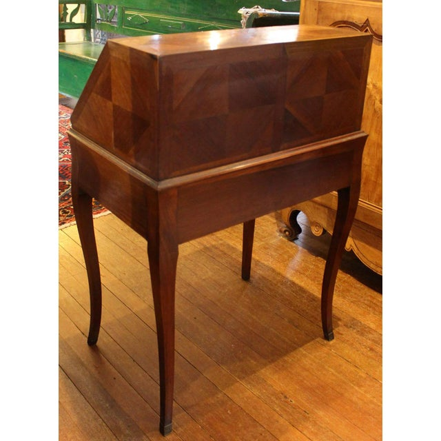 A country French cherry bonheur du jour (lady's desk) raised on graceful cabriole legs, c.1860, with interesting steel...