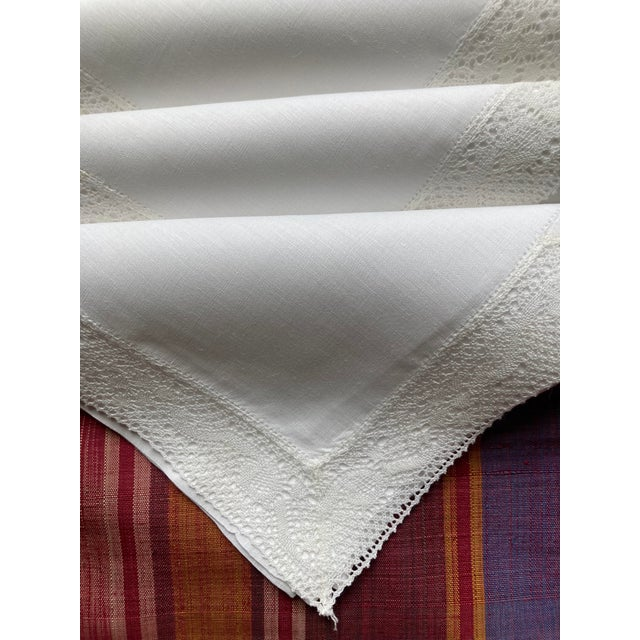 A set of 6 white linen lace edged cocktail napkins starched,pressed and ready to serve