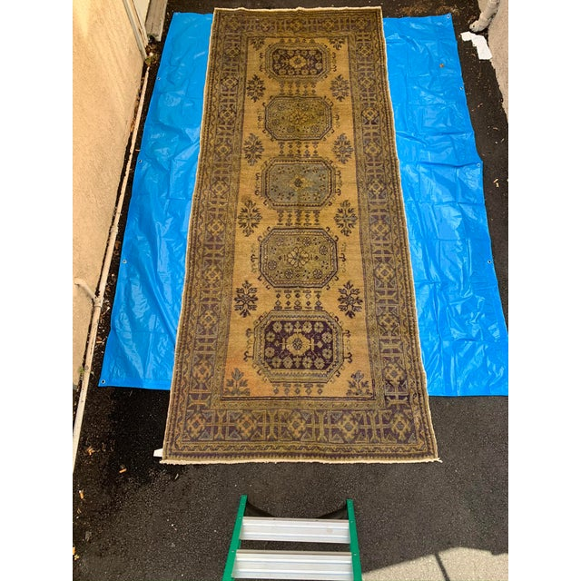 This amply wide vintage Turkish runner from the mid 20th Century, is designed with floral and geometric patterns...