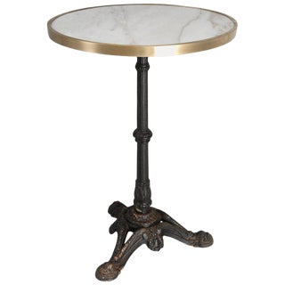French Bistro Table With a Marble Top and Brass Edging