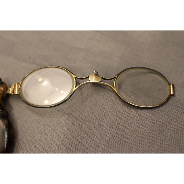 Pair of 19th century French gilt silver Lorgnette; faux tortoise and silver holder; leather case for storage. 2nd...