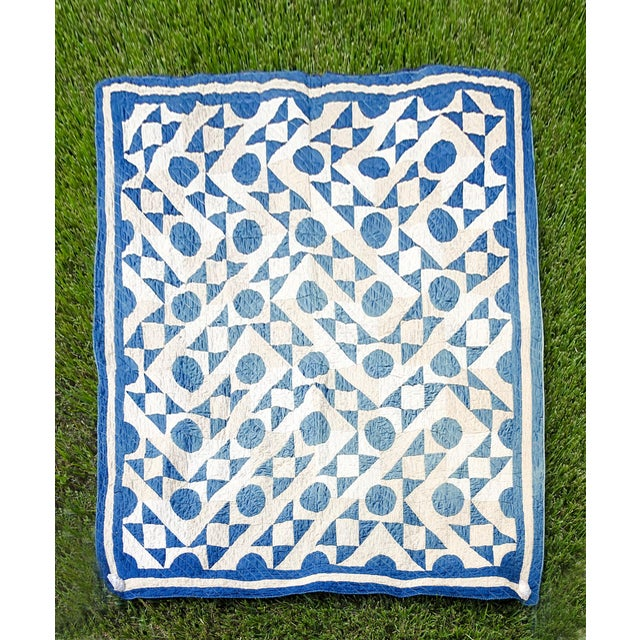 Early 20th century blue and white quilt in a modified Drunkard's Path pattern. Very graphic, has been hanging on the wall...