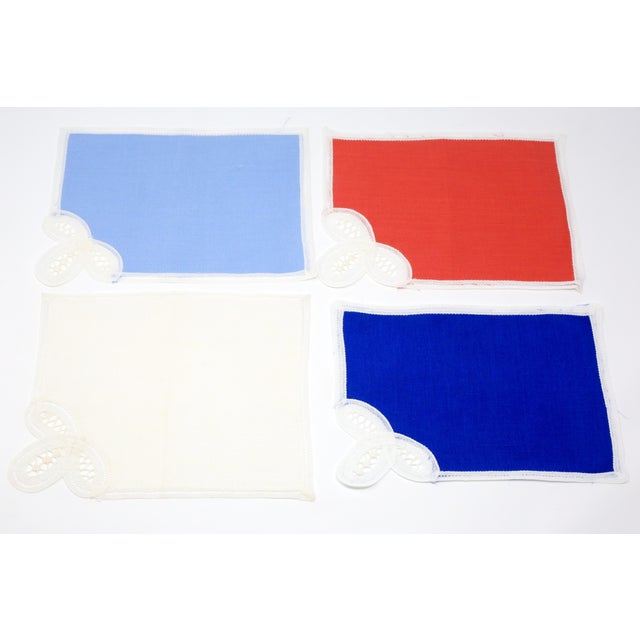 "A set of 19 linen demi placemats in red, royal blue, light blue, and white. Excellent condition. Approximate size: 7 3/4""..."
