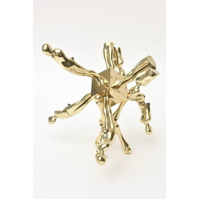 This amazing two part one of kind Ernest Trova vintage sculpture is polished brass.It is from his known falling man...
