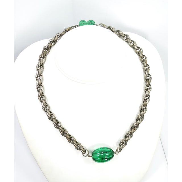Offered here is an Art Deco necklace of emErald pate de verre poured glass and interlocking chain, from France in the...