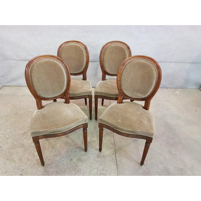 Hand carved frame and solid tapered, fluted legs. Original beige raised diamond pattern velvet upholstery in very good...