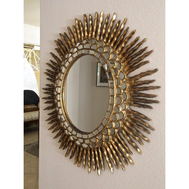 1970s Spanish Colonial Sunburst Oval Giltwood Wall Mirror For Sale - Image 4 of 11