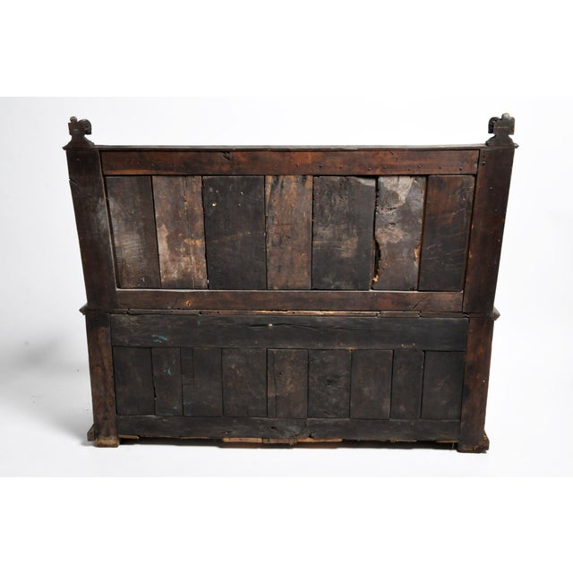 This 17th century oak bench is richly carved with Gothic motifs. Despite its age, the piece has a very solid frame with...
