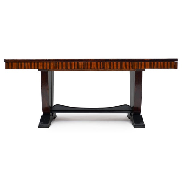 An incredible piece from the French Art Deco period, this dining table is a strong and dynamic additional to a home. The...
