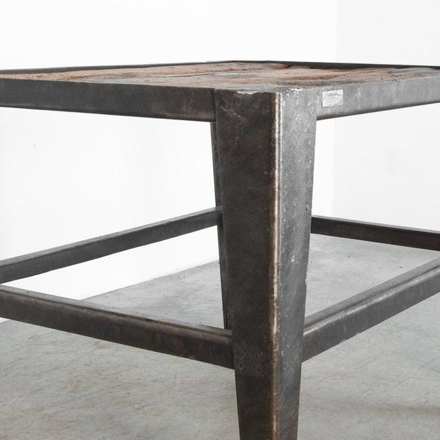 Produced in Czech Republic, circa 1950. This sturdy functional table is framed with angled steel, and topped with a...