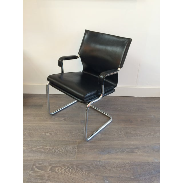 """Black leather and tubular chrome """"Uno"""" chair made by Marcatre and designed in 1973 by Paolo Deganella and Gilberto..."""