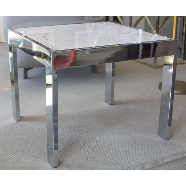 Beautiful pair of marble and steel side tables with flat bar frame in chrome finish.