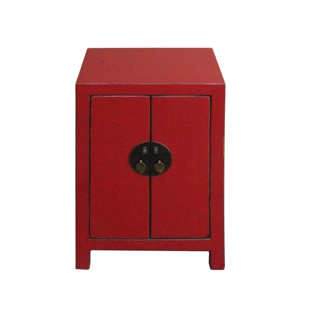 This is a handmade Chinese oriental end table nightstand with two doors. The surface is finished with distressed red...