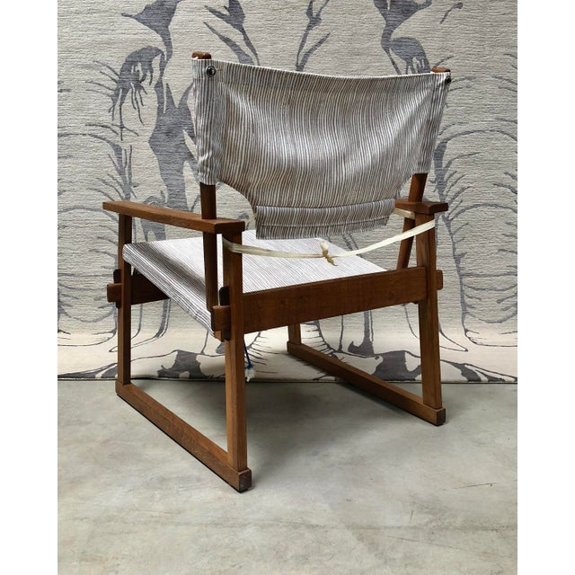 Handsome and rare, safari-style Model 60 chair, designed by Danish designer Poul Hundevad (most famous for his Guldhoj...