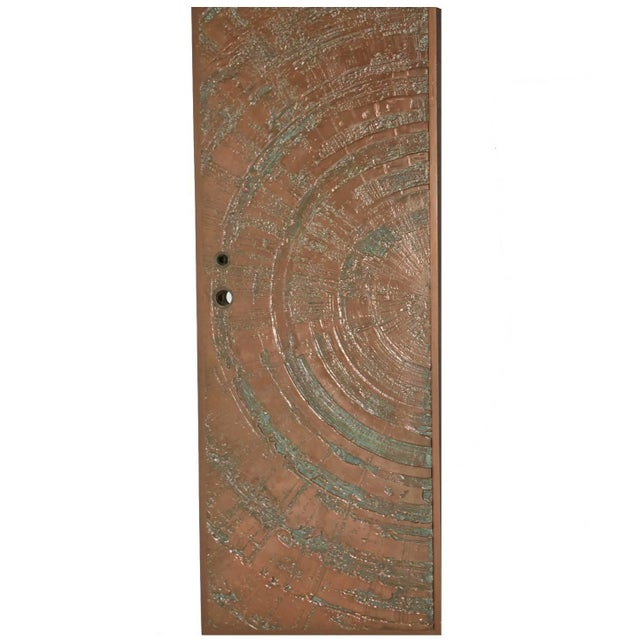By Forms and Surfaces circa 1960-1970, a textured, bonded and poured bronze door in an abstract Sunburst design. An...