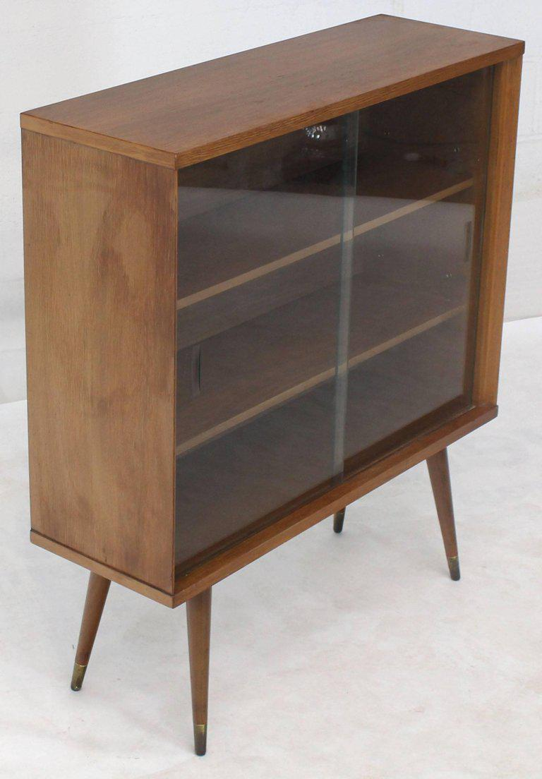 Small Mid Century Modern Bookcase With Adjustable Shelves And Glass Sliding  Doors Floating On Dowel