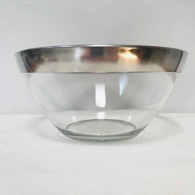 Vintage, mid-century modern glass bowl with a wide sterling silver band. This classic Dorothy Thorpe bowl can be used for...