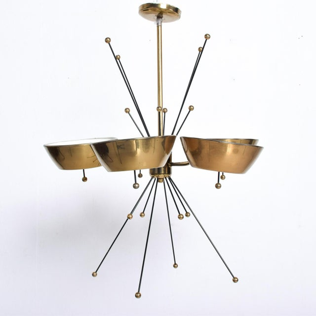 We are pleased to offer for your consideration a beautiful chandelier made in Italy, Circa the 1960s. Brass with glass and...