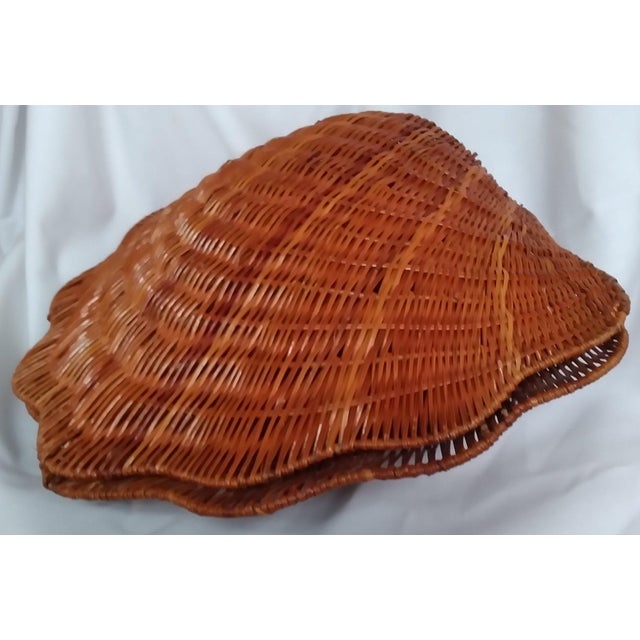 """This Palm Beach style large, wicker 16"""" clam shell is hinged and in excellent condition. The color is a blend of natural..."""