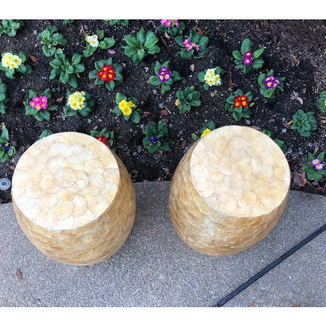 Luminous capiz shells cover these two low stools. Styled as Chinese Garden stools, these are the perfect fit for a casual...