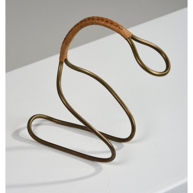Carl Auböck ll bottle holder with original caning Made in Austria in the 1950s. Brass bottle holder is secure and holds a...