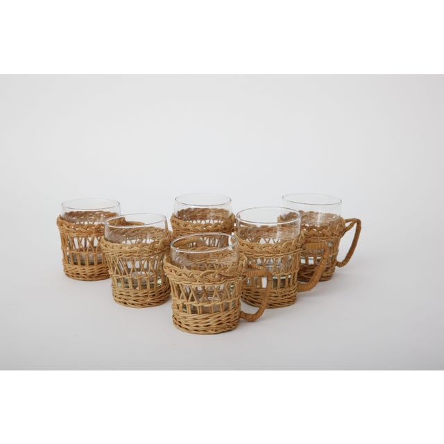 Charming French vintage glasses with woven rattan removable holders - set of 6. Beautiful boho chic pieces!