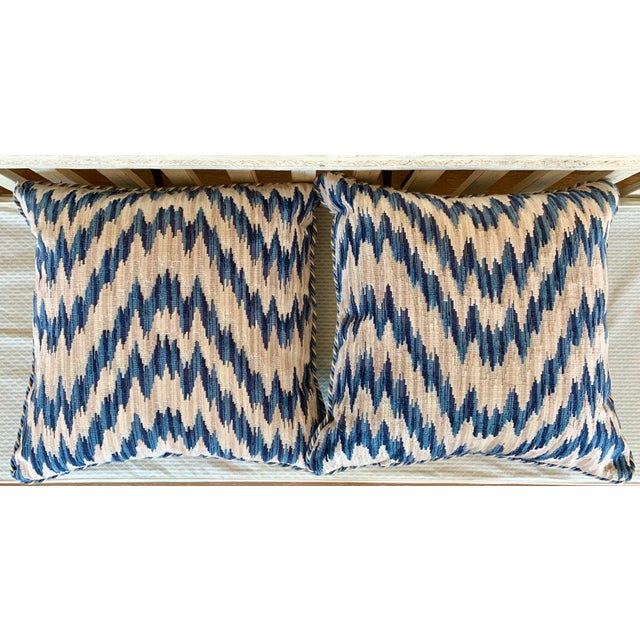 Pair of Clarence House cut velvet chevron pattern pillows with blue and white braid trim. Contemporarily made.