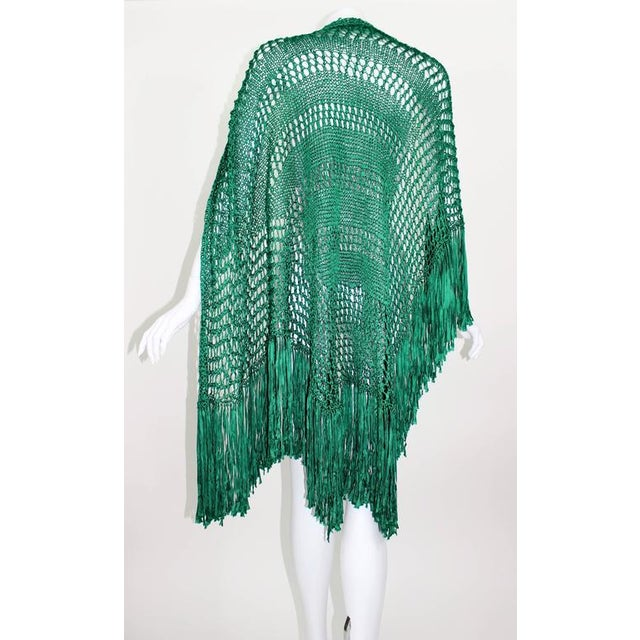An exquisite vivid emerald green handmade shawl with long fringe trim. Feels like silk. Handmade Triangle shape....