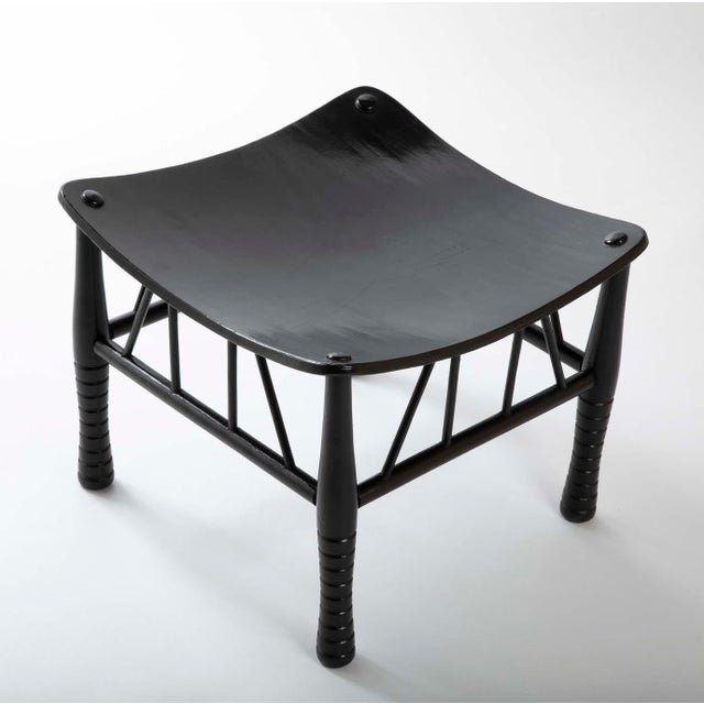 19th century English Thebes stool with ebonized lacquer finish, the solid seat supported by four turned legs united by...