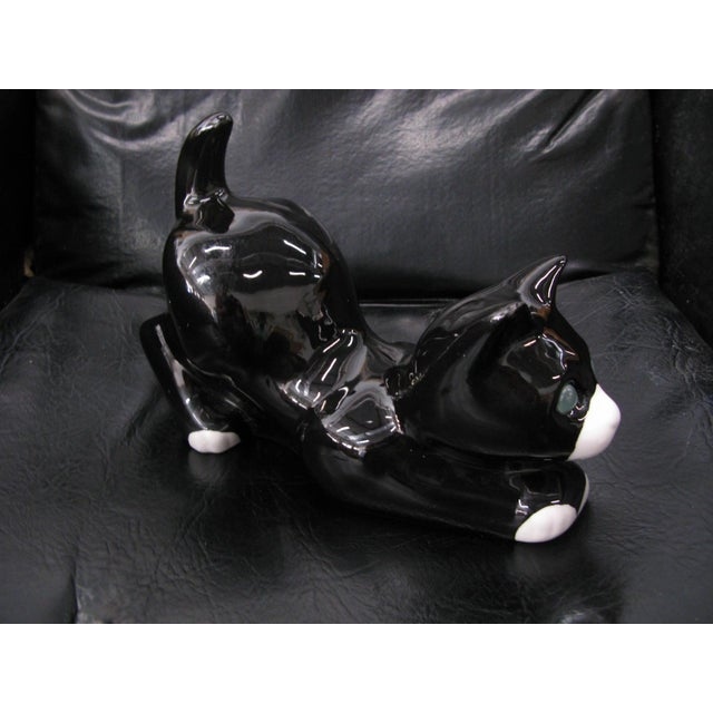 Alcobaca ceramic black & white kitty cat with green eyes. Made in Portugal. In good condition. There is some crazing. No...