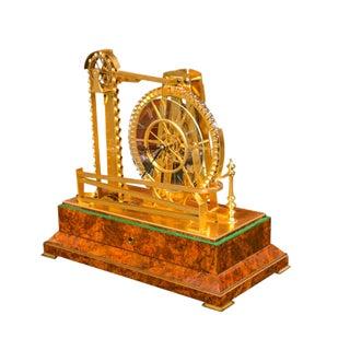 A Gilt Brass Waterwheel Timepiece by Peter Bonnert For Sale
