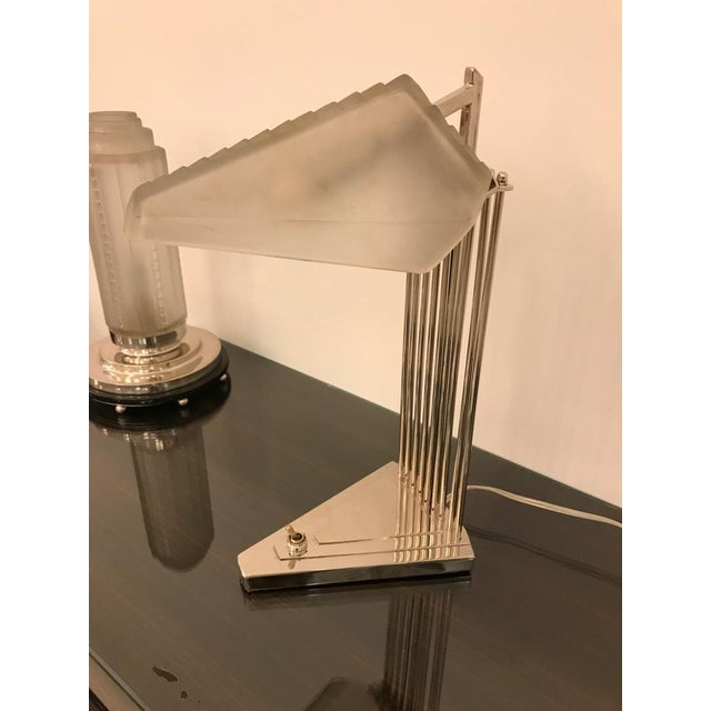 French Art Deco desk or table lamp signed by Genet et Michon. Having geometric shade in frosted glass with polished...