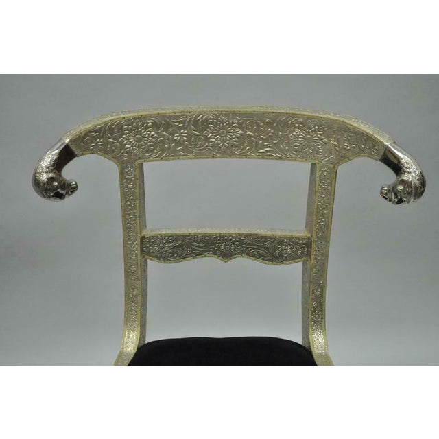 Pair of Rams Head Metal Wrapped Anglo Indian Regency Style Dowry Wedding Chairs. Item features wooden frames clad in...
