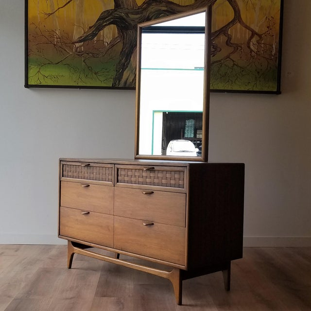 A beautiful four-drawer dresser with a mirror designed by Warren Church for Lane Furniture's 'Perception' series. The...