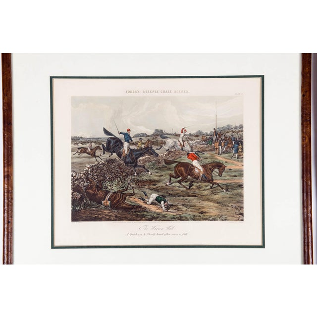 Antique set of four late 19th century hand colored lithographs of forest steeple chase scenes. Each one is professionally...