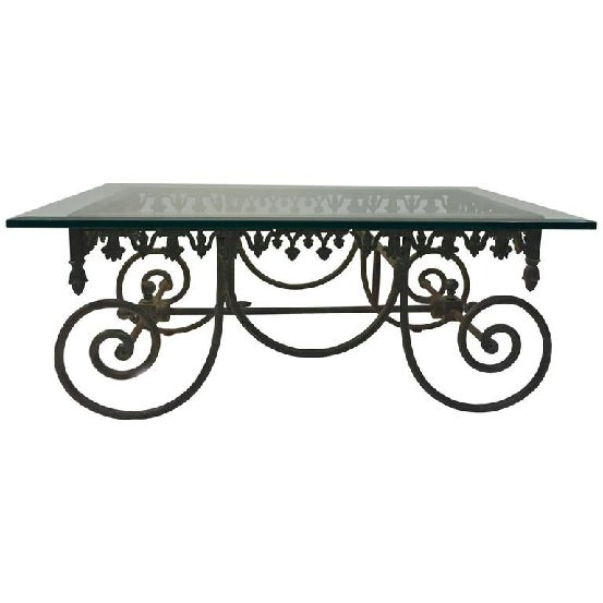 """An exceptional 19th century wrought iron French Bakers table with scrolled frame and 3/4"""" thick glass top. Glass 47"""" x 27"""""""