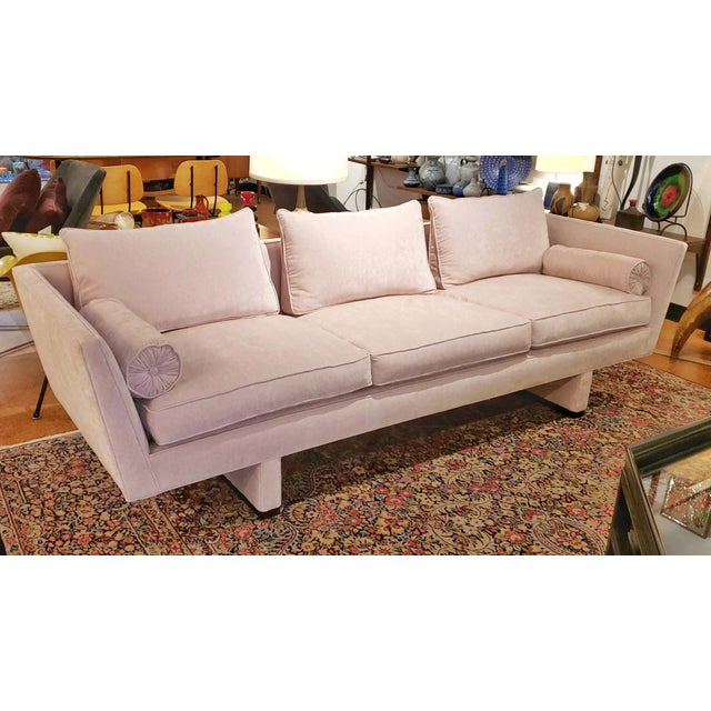 Pretty in pink! A rare model 5485 tuxedo style sofa with dramatically flared arms and an upholstered sled base in plush,...