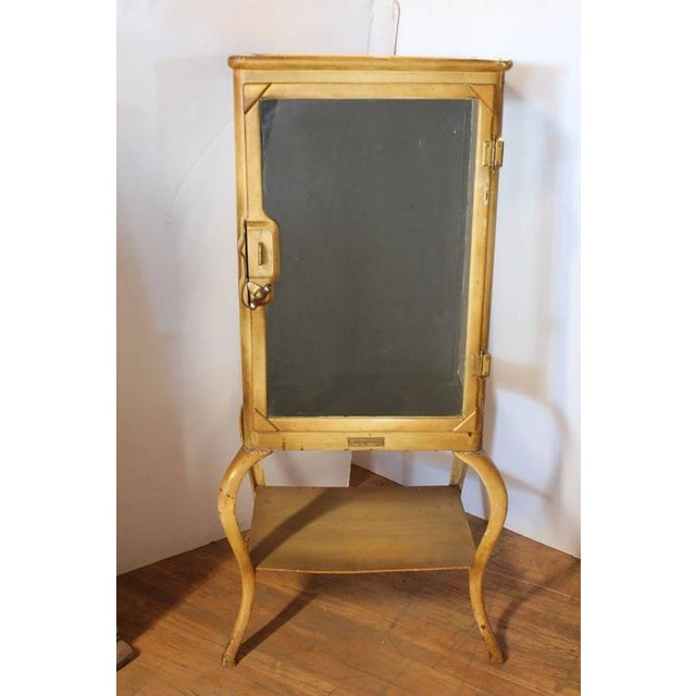 Antique American medical cabinet with original hardware. This piece would look great in a traditional style room.