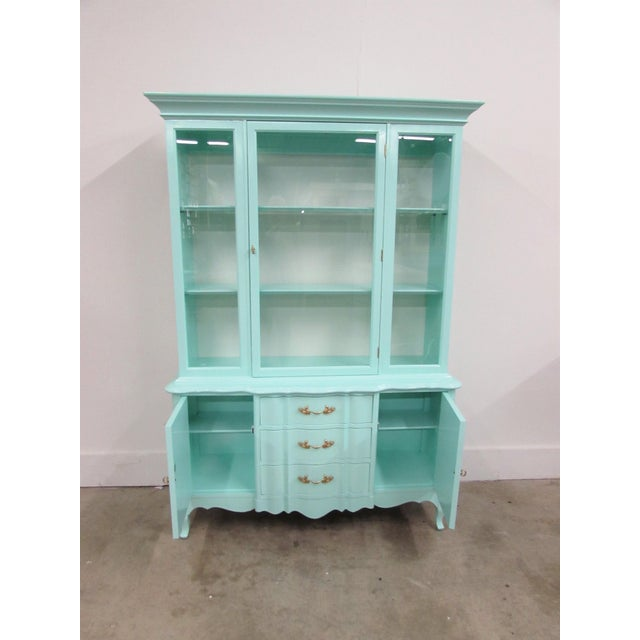 French Étagère Lacquered in Biscayne Shore comes in one piece with one swinging door on top opening to two shelves, the...