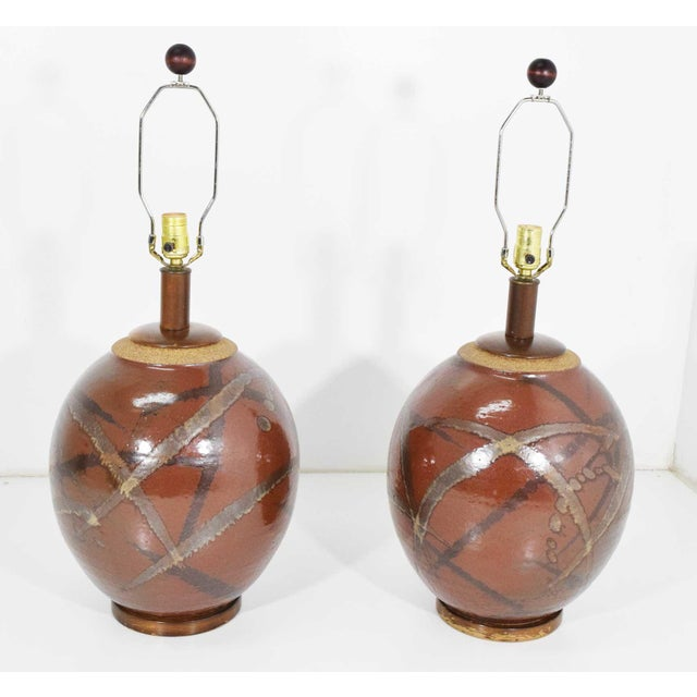 Beautiful pair of ceramic glazed table lamps by Brent Bennett. Shades not included. Height is to top of socket.